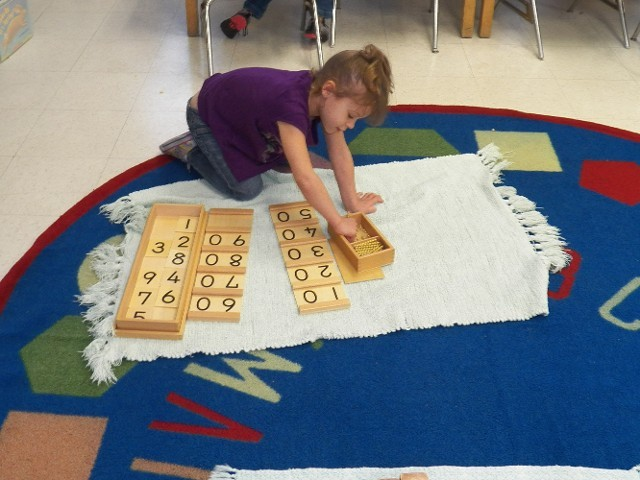 Girl Playing With Number Blocks